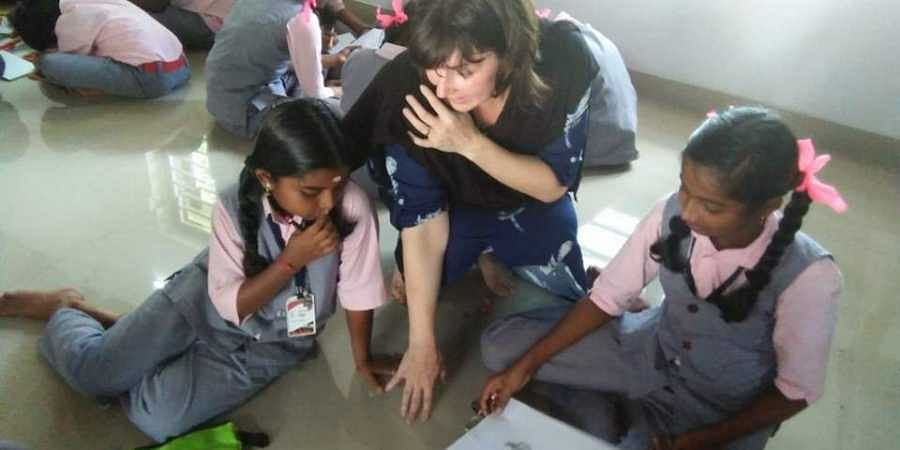 Elisa is even helping Malayalees to learn Malayalam