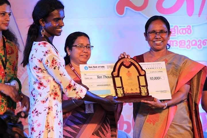 Sreya receives an award at the state transgender arts festival from Minister KK Shailaja
